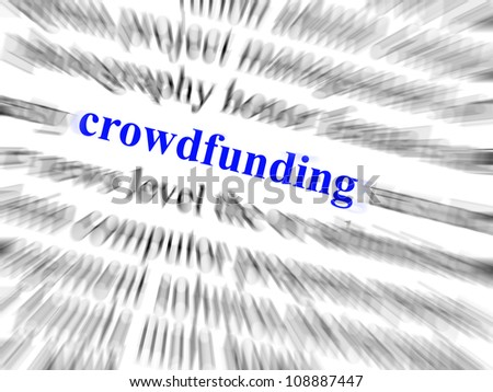 Crowdfunding in blue sharp text surrounded by blurred text in black and zoom effect. - stock photo