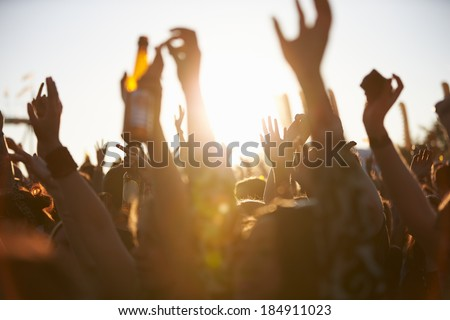 Crowds Enjoying Themselves At Outdoor Music Festival - stock photo
