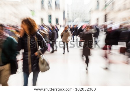crowds of people in the city with creative zoom effect - stock photo