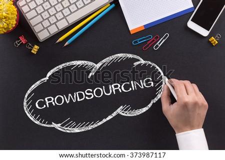 CROWDSOURCING written on Chalkboard - stock photo