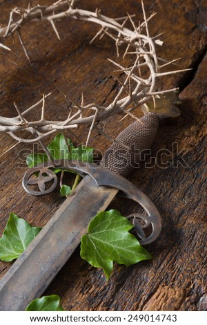 Crown of thorns and sword symbolizing Jesus' death and resurrection at Easter - stock photo