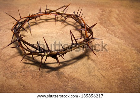 Crown of thorns over brown marble background, copy space. Christian concept of suffering. - stock photo