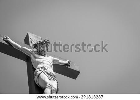 Crucifix made of marble with blue sky in background. France, Provence Region. - stock photo