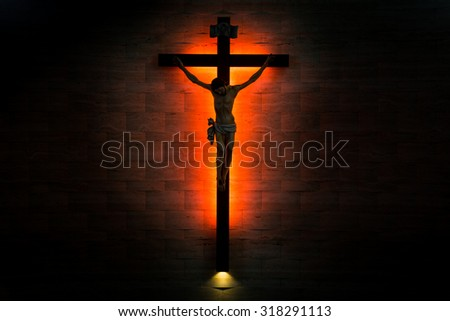 Crucifix of the Catholic Christian faith in silhouette - stock photo