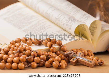 crucifix ,rosary and  holy book - stock photo