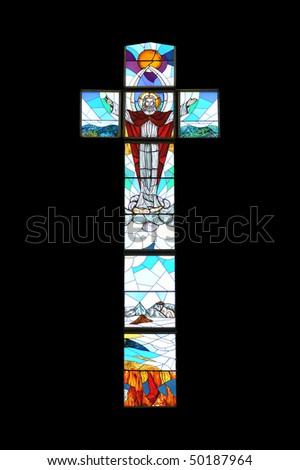 Crucifix shaped stained glass window on church in Dominican Republic - stock photo