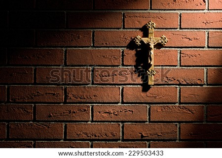 crucifix with Jesus on brick wall - stock photo