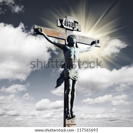 Crucifixion of Jesus Christ in the sky and the sun - stock photo