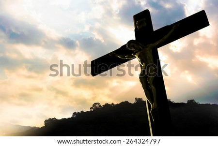 crucifixion of Jesus Christ with dramatic sky in background - stock photo