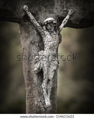 Crucifixion of Jesus. Close up of ancient cross at the abandoned grave. - stock photo