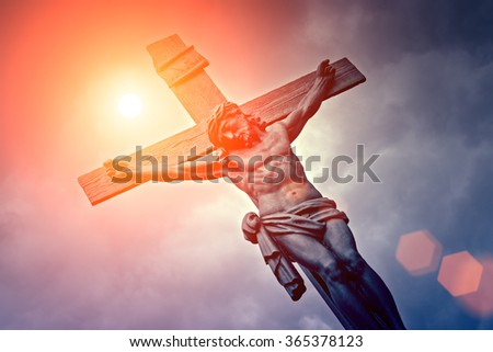 Crucifixion with sunlight - stock photo
