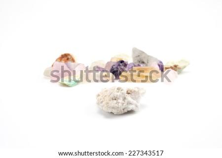 Crude gemstones semiprecious gem amethyst isolated on white background - stock photo