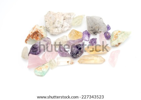Crude gemstones semiprecious gem amethyst isolated on white background - stock photo