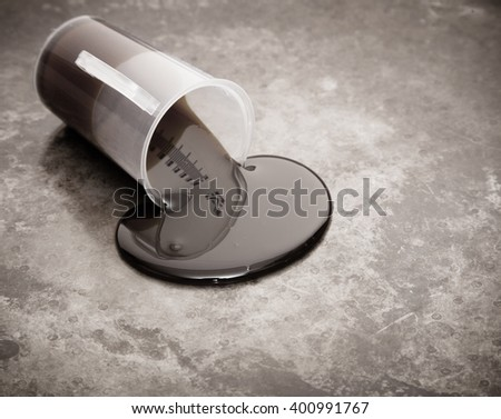 Crude oil spill on metal background - stock photo