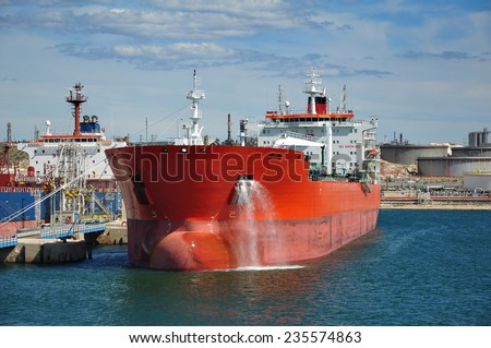 crude oil tanker is loading in the port - stock photo