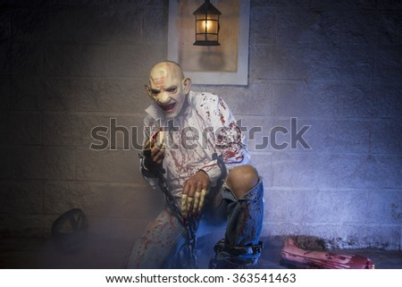 cruel, halloween monster chained with bloody hook, night scene and terror - stock photo