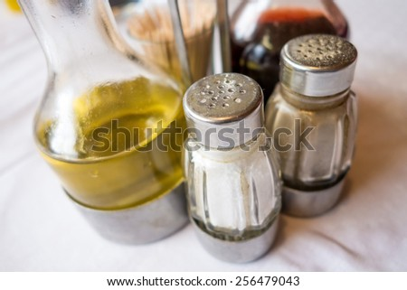 cruet and salt shaker on a table in a restaurant - stock photo