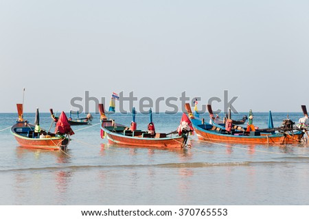 Cruise boat for tourists on the beach. Thailand, Phuket Island. - stock photo