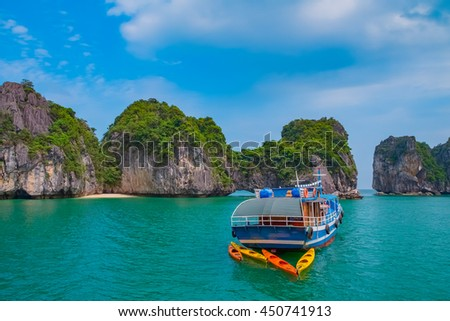 Cruise boat in Halong Bay, Vietnam, Southeast Asia. UNESCO World Heritage Site. - stock photo