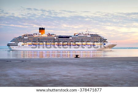Cruise liner departure from Lisbon port at sunset, Portugal - stock photo