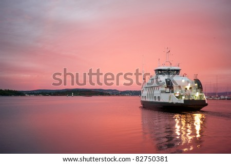 Cruise liner floating away from the Olso harbor at dawn - stock photo