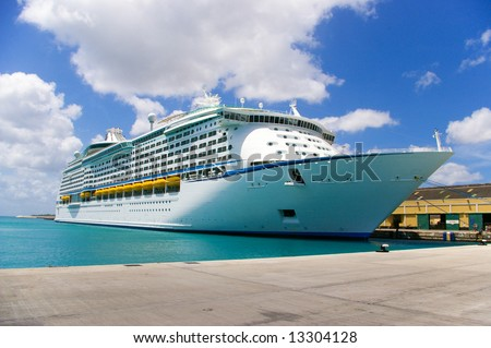 cruise ship anchored in a caribbean pier - stock photo