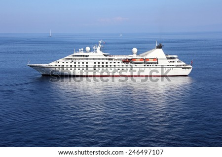 Cruise ship anchored off the coast - stock photo