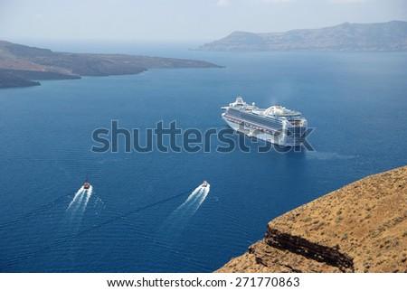 Cruise ship and two boats near Santorini. Greece - stock photo