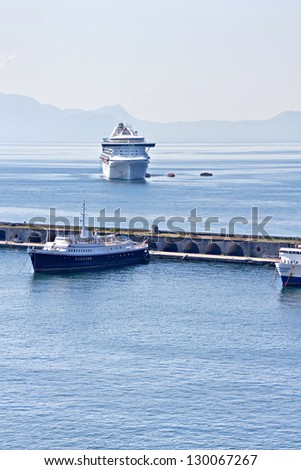 Cruise ship arrives in the harbor - stock photo