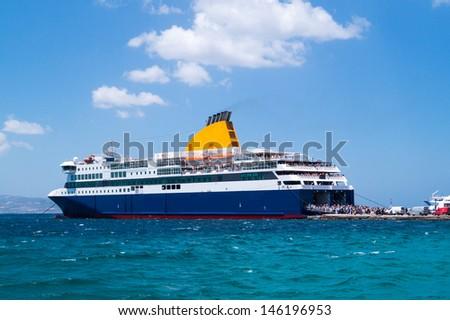 Cruise ship at Mykonos port, Greece - stock photo