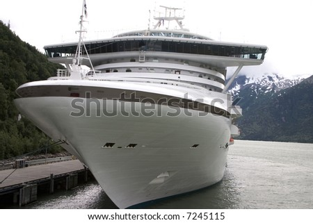 Cruise ship at port in Alaska on a cloudy day - stock photo