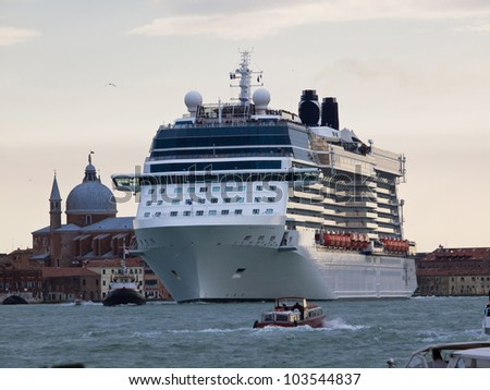 cruise ship at sunset in Venice - stock photo
