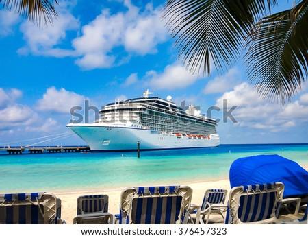Cruise Ship close at the beach on a tropical Island. - stock photo