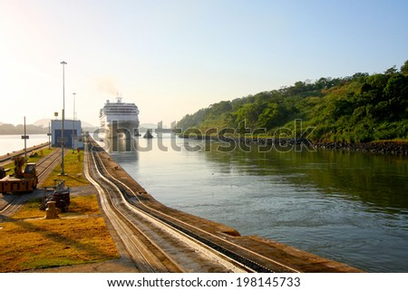 Cruise ship enters the Miraflores lock in the Panama Canal. Early morning on a beautiful sunny day in Panama. - stock photo