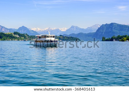 Cruise ship in front of snow covered Alps mountains peaks on Lake Lucerne, central Switzerland - stock photo
