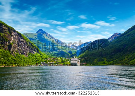 cruise ship in norway fjord - stock photo