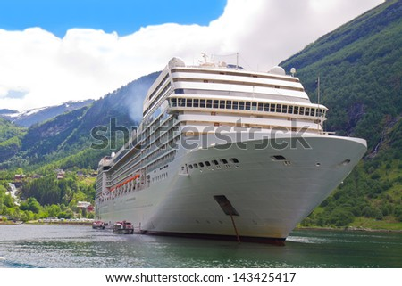 Cruise ship in  Norwegian fjords - stock photo