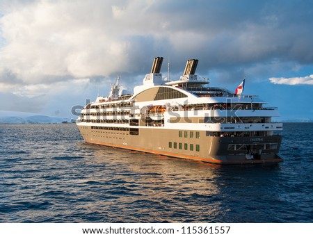 Cruise ship in sunset light - stock photo