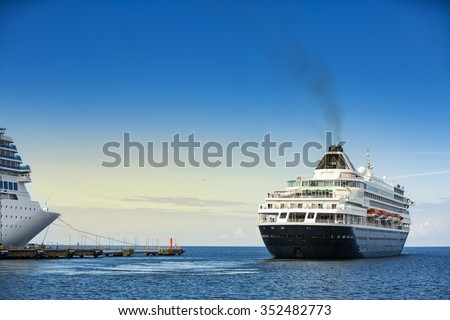 Cruise ship leaving the dock. Big ocean liner leaving a port. - stock photo