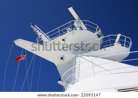 Cruise ship mast and red flag - stock photo