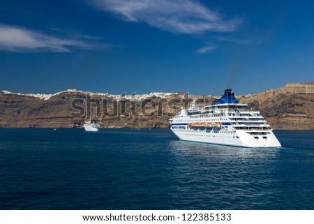 cruise ship near island of Santorini Greece - stock photo