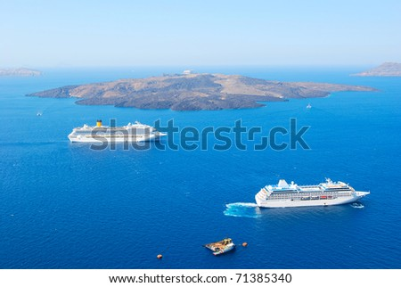 cruise ship near volcano on island of Santorini - stock photo