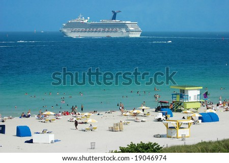Cruise ship passing by a beach resort in South Beach, Miami, Florida - stock photo