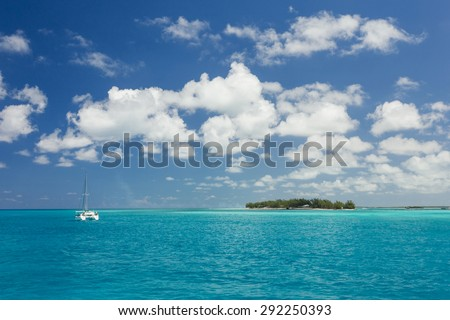 Cruise ship sailing along the coast line in the Bahamas - stock photo