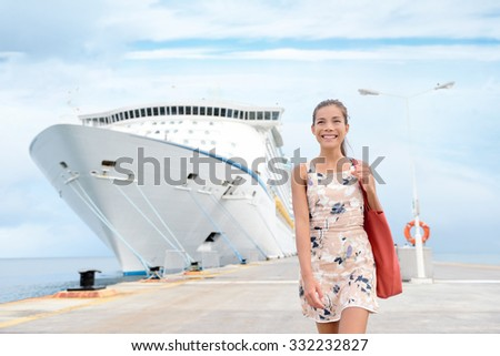 Cruise ship travel going shopping in port on travel cruise vacation at sea. Happy mixed race Asian Chinese Caucasian woman in dress by luxury cruise liner boat. - stock photo