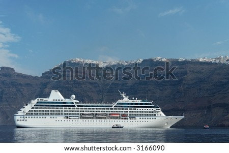 Cruise ship with the cliff line of a mediterranean island - stock photo