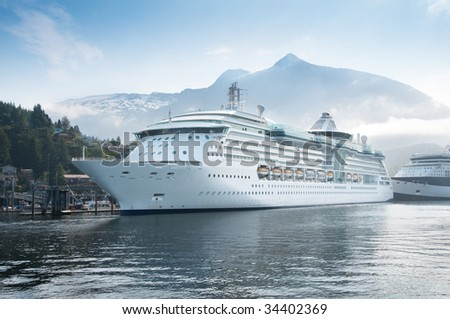 Cruise ships docked at the harbor of Ketchiken, Alaska. - stock photo