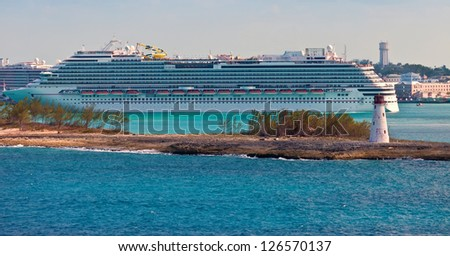 Cruise ships entering and departing from the port of Nassau, in the Bahamas. - stock photo