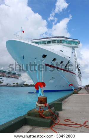Cruise ships in the clear blue Caribbean ocean docked in the port of Nassau, Bahamas - stock photo