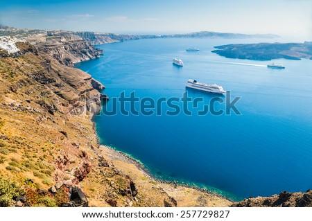 Cruise ships near the Greek Islands. Santorini island, Greece. Beautiful landscape with sea view - stock photo